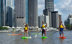 Incentive group paddle board on Brisbane river with dmc australia