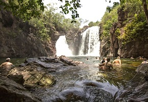 During one day trip from Darwin incentive travel delegates swim in spectacular waterfalls of the National Park with dmc Australia