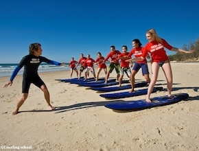 In Australia, on the Gold Coast Incentive Group enjoy surfing lesson with dmc Brisbane, UNIQ Travel & Incentives Australia
