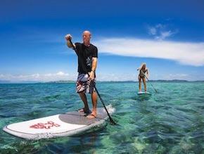 In Australia, on the Gold Coast Incentive Group is enjoying standup paddle boarding with dmc Brisbane, UNIQ Travel & Incentives Australia Coast